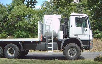 Oilfield service truck with fuel tank and provision for workshop container