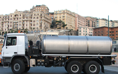 Custom-built water tanker for drinking water transportation in difficult terrain.